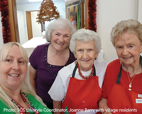 SCC Lifestyle Coordinator, Joanne Barry with village residents